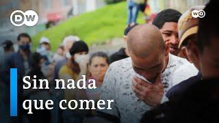 En Bogotá, los trapos rojos en ventanas y balcones se han convertido en llamadas de auxilio. Significan que las familias no tienen qué llevarse a la boca.