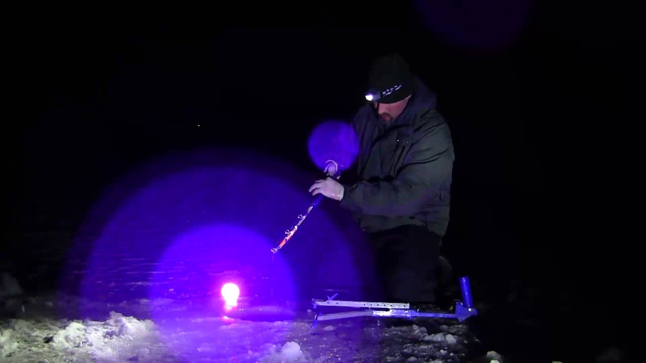 charging glow in the dark jigs with a blacklight burbott fishing, Reel Combo