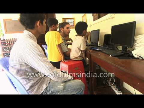 Children from Cambodia learn how to use iPad and computers