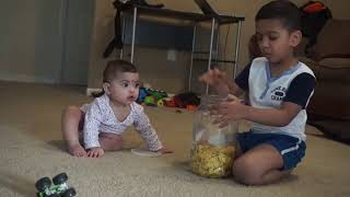 9 months baby fighting with her big brother for banana chips