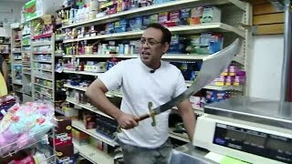 Cashier fights off sword-wielding robber with BIGGER sword