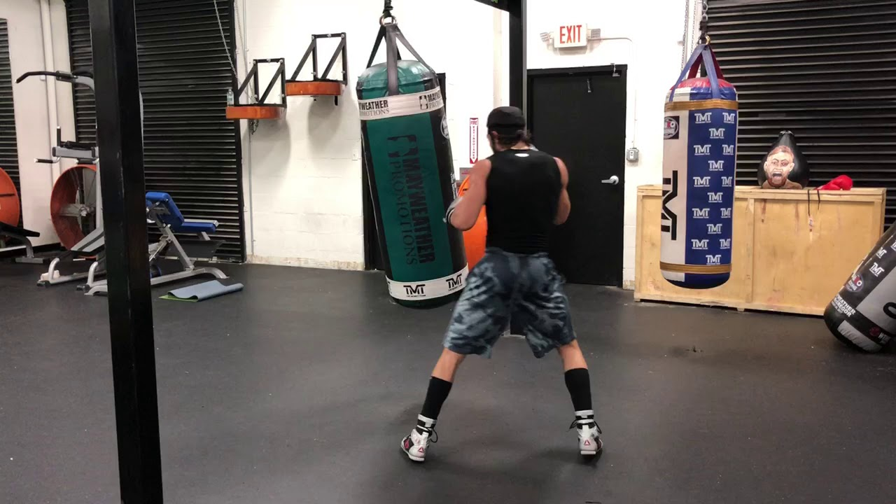 The watchful eye of Floyd Mayweather Sr. Advises his fighter on the heavybag