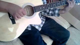 My honey playing guitar.