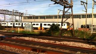 Workers push derailed train carriage in Ilford back into place