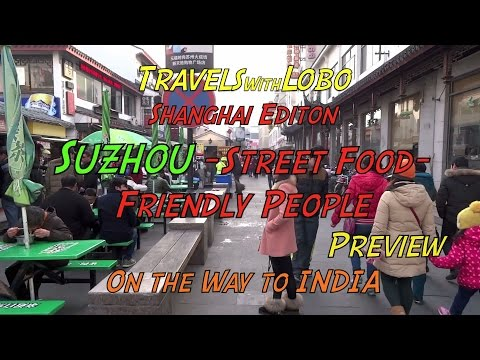 SUZHOU , China - Street Food - Friendly People - Dogs, Birds, Fish......UNESCO World Heritage Site