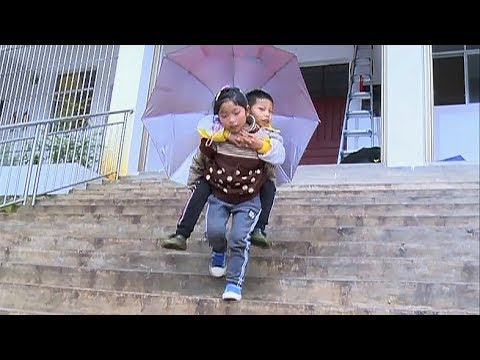Download Youtube: Nine-year-old girl carries brother to school every day
