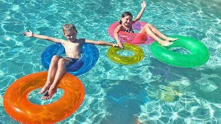 LEARN COLORS in Swimming Pool with Colored Ring Toys Nursery Rhyme Songs