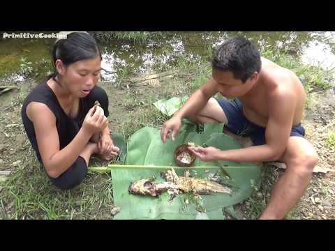 Primitive Technology - Catch fish and cooking fish on a rock - Eating delicious