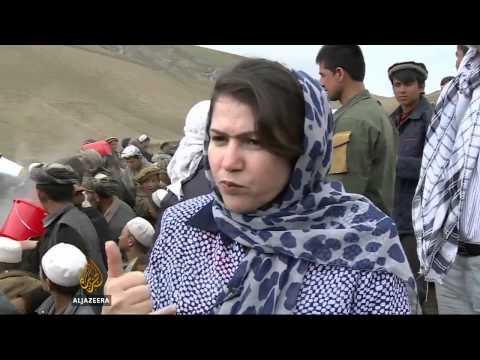 Rains worsen conditions for Afghan landslide survivors