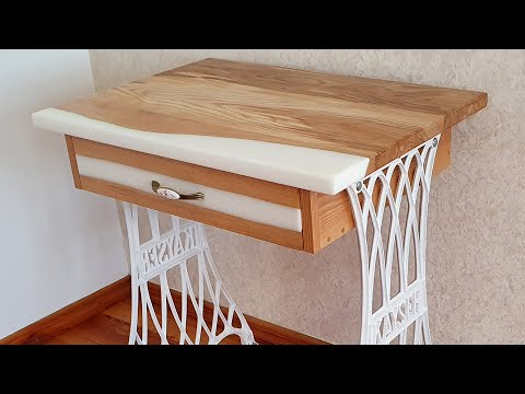 Epoxy table with sewing machine legs