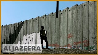 Israel's illegal separation wall .imprisons. Palestinians, From YouTubeVideos