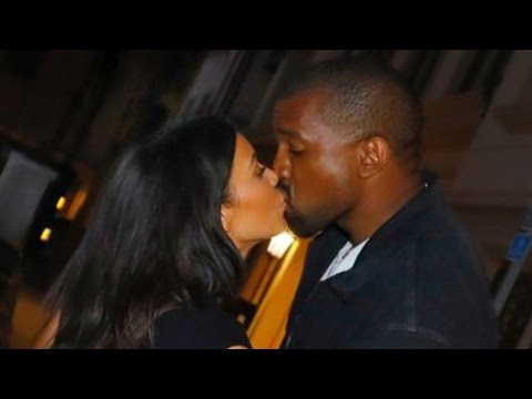 Kim Kardashian and Kanye West Kiss for the Cameras