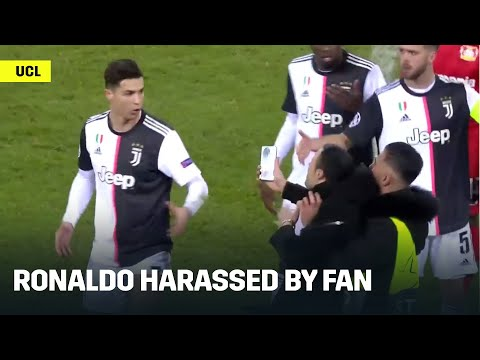 Cristiano Ronaldo Gets Harassed By Pitch Invader