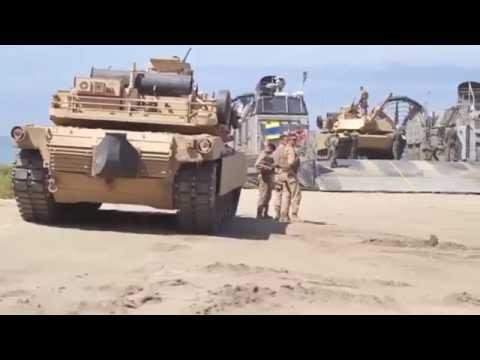 US Marines, Tank  M1 Abrams Amphibious. A big Navy Hovercraft transport.