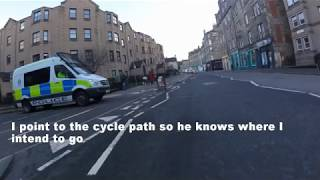 Cyclist & Policeman argue over who has right of way.