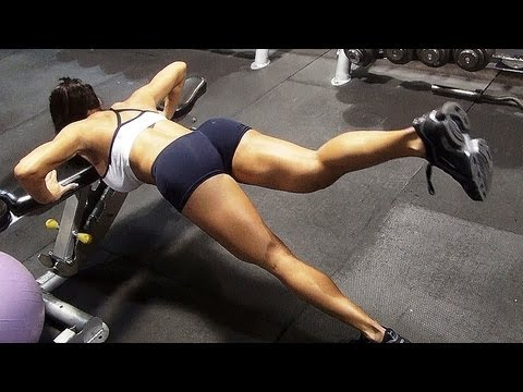 Intense Arm Workout at Fitness center: Female Fitness Model Michelle Lewin