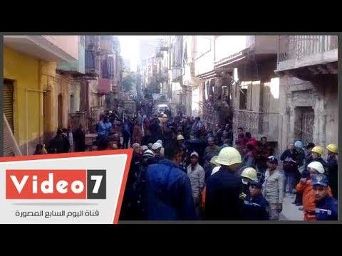لحظة انتشال المصابة السادسة من أسفل عقارات روض الفرج  - 14:22-2017 / 12 / 12