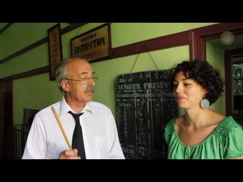 Guide to bakers, dairymaids and the teacher with the cane at Bunratty Folk Park, Clare