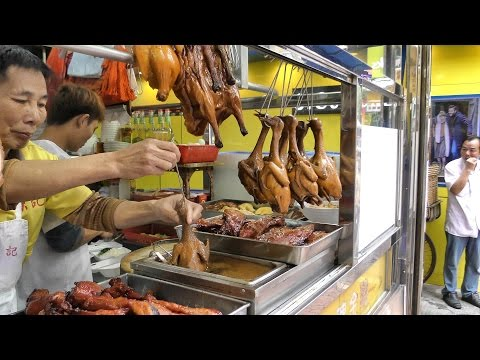 Hong Kong Street Food. The Roasted Bird Dipped in Sauce