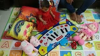 9 months aashna baby  playing on her first children's day with her gift piano
