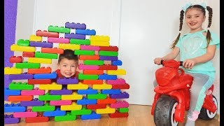 Richard and Dominika Playing with Toy Building Blocks