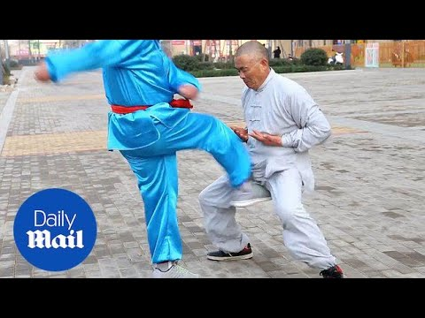 Kung Fu master shows the art of being painfully hit in the crotch - Daily Mail