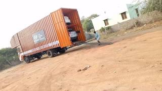 Guess?  How to cars unloading way from container to showroom