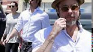 Ink-redible father! Brad Pitt flashes new tattoo dedicated to wife and children as they enjoy family