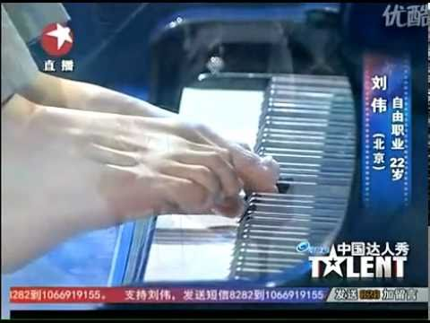 guy with no arms plays piano and wins China's Got Talent
