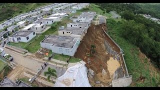 Ground Collapse Leaves Eight Houses on the Edge of Huge Hole In Puerto Rico