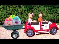 Diana And Roma Ride A Children's Car And Find Toy Surprises
