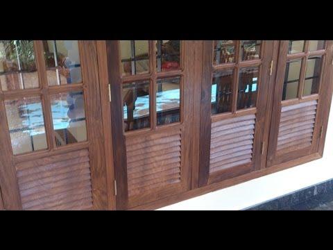 Kerala style wooden window frame designs doovi for Window design kerala style