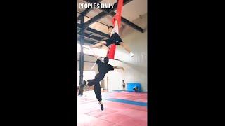 How many twirls does the female acrobat make?