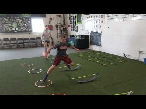Athletes, Nicole and Andrew, working on plyo-agility and quickness