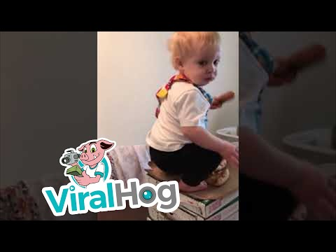Cheeky-Toddler-Caught-Helping-Himself-to-Pizza-ViralHog
