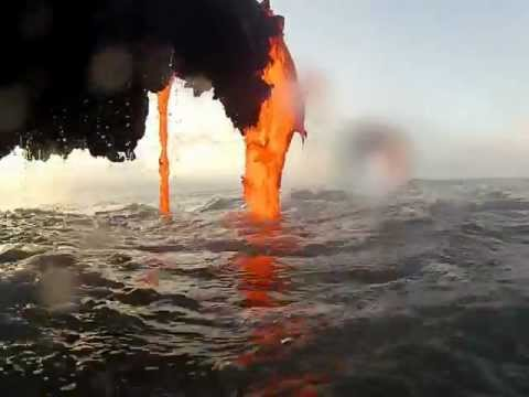 Amazing footage of lava creating a black sand beach