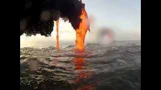 Amazing footage of lava creating a black sand beach