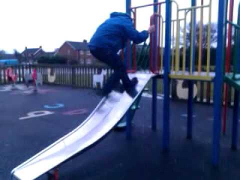 Nathan Mathews slips on slide.
