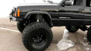 2000 Jeep Cherokee Sport with Lift kit. S4081