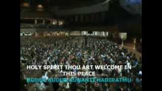 "Benny Hinn sings ""Holy Spirit Thou Art Welcome In This Place"""