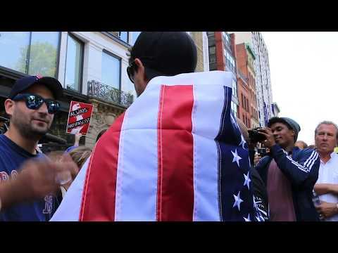 Man wears American Flag outside Boston Free Speech Rally