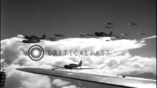 Aerial views of several US Army Air Corps aircraft: C-47 dropping paratroopers, V...HD Stock Footage