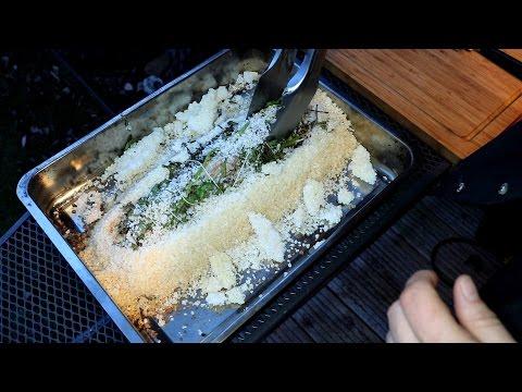 Schweinelende in einem Kräutermantel, in der Saltzkruste gegart, dazu ein Kartoffelgratin