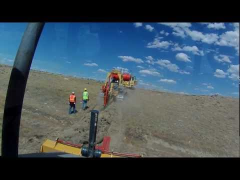TerraSpan Utility Plow Train   Fiber Duct Plowing   Eastern Wyoming  Komatsu Cable Plow3