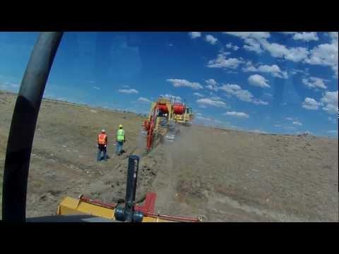 TerraSpan Utility Plow Train   Fiber Duct Plowing   Eastern Wyoming  Komatsu Cable Plow3