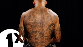 Andre Gray Breaks Down His Black History Tattoos