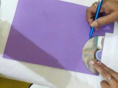 Waste material craft ideas - paper napkin holder from old CD
