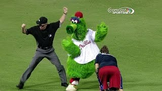 Phillie Phanatic does the wobble with umpire