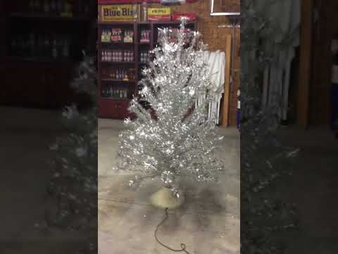 Vintage tree with musical rotating base