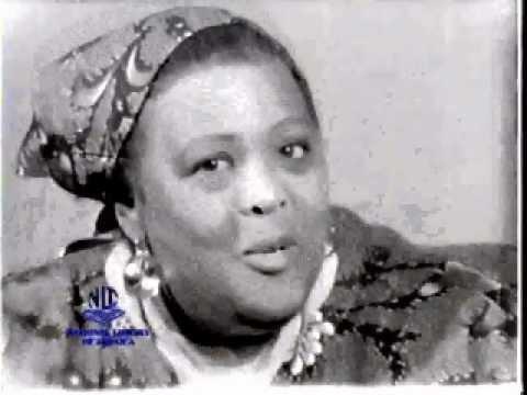 """When Trouble Tek Man, Pickney Boot Fit Him!"" - Miss Lou Talks Jamaican Proverbs.avi"